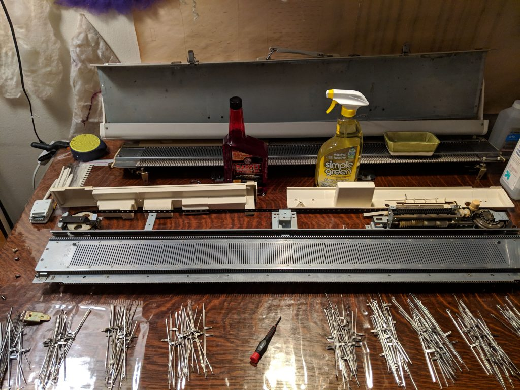 cleaning knitting machine bed